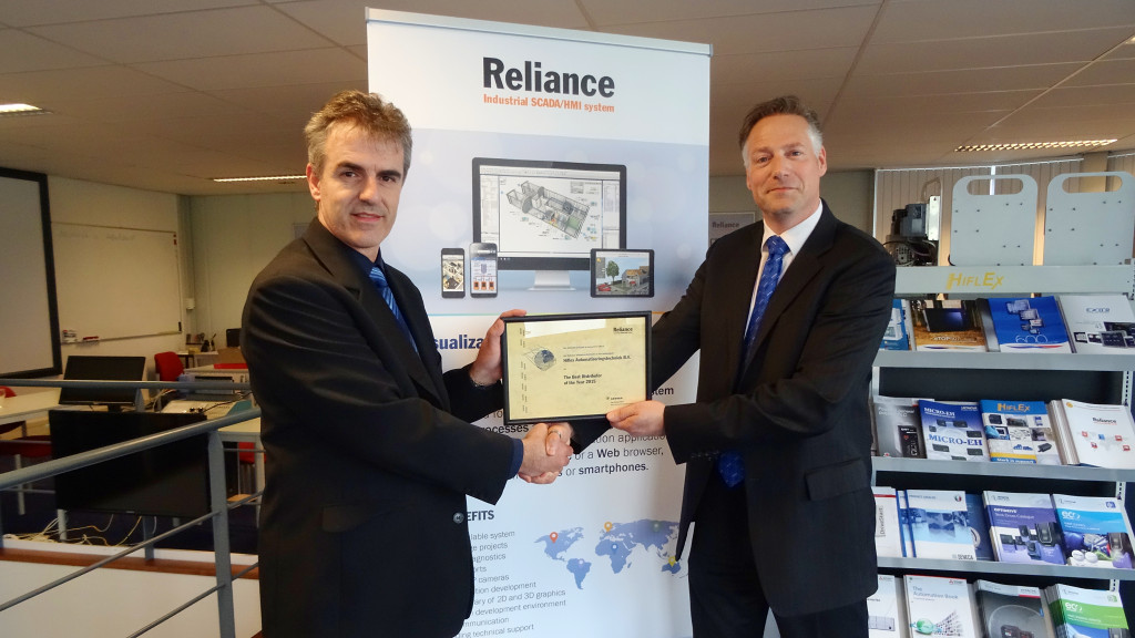 A Hiflex representative is being awarded a certificate for The Best Distributor of the Year 2015 from Zbynek Pilny (Director of Industrial Automation Department).