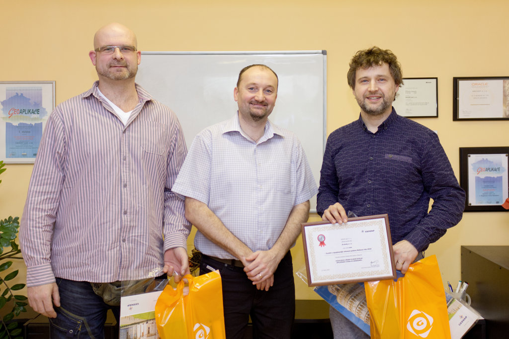 The prize for second place was presented to Mr. Jirasek (JS stavby; right) and Mr. Hromek (left)
