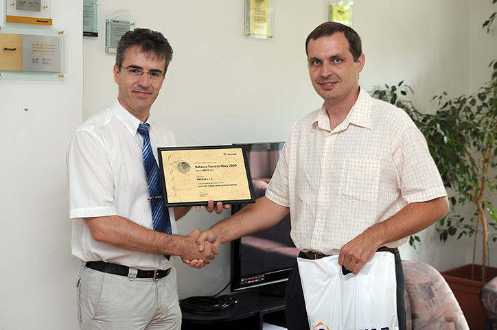 Mr. Tomas Cach of PROTECO accepts the first prize