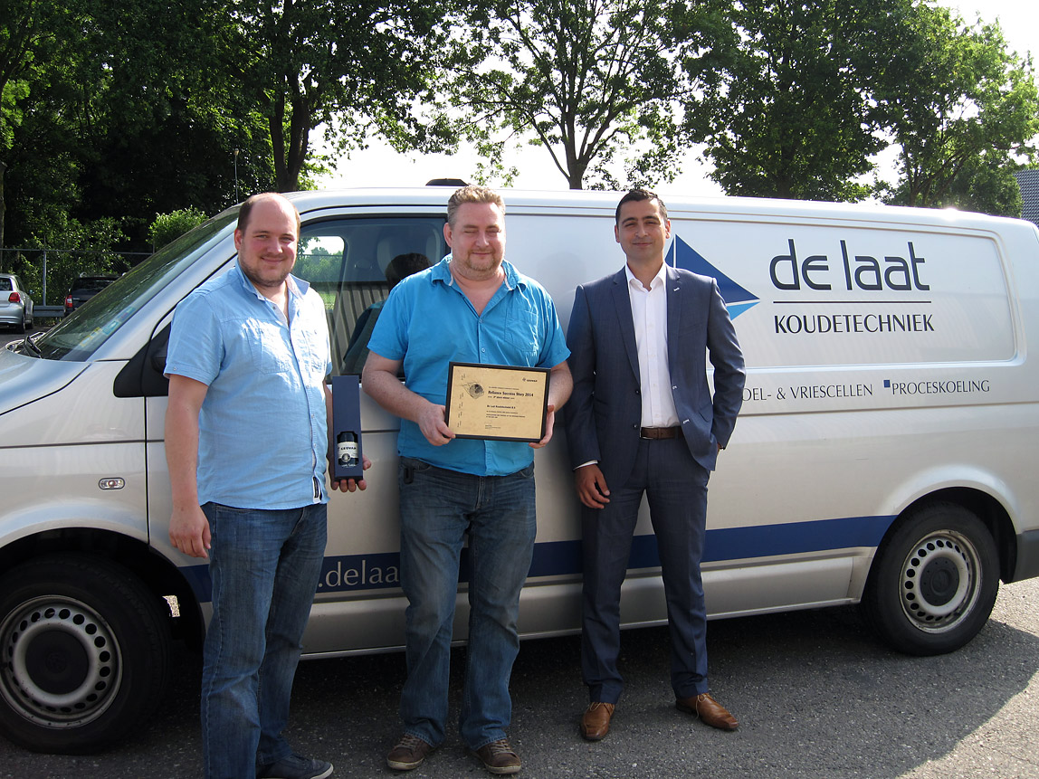 Patrick Raaijmakers and Kevin Leeferink, representatives of De Laat Koudetechniek, accept the third-place prize, Reliance Success Story Awards 2014