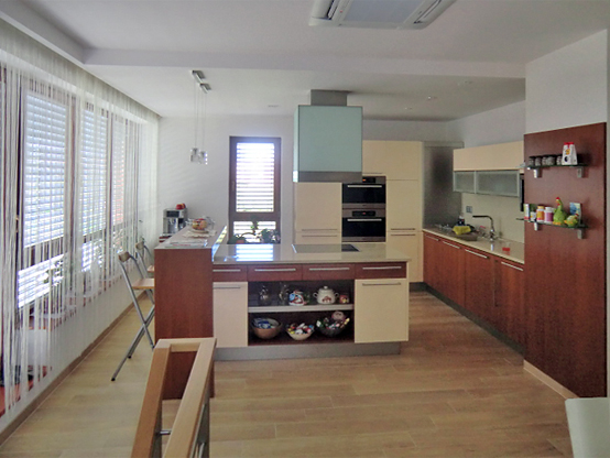A photo of the kitchen taken from the staircase